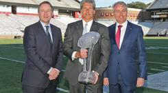 At Boston College's Alumni Stadium for the unveiling of the Keough-Naughton American Football Trophy were (l to r) Stephen Kavanagh, CEO Aer Lingus, Brad Bates, Boston College Director of Athletics and Neil Naughton, chairman of the Aer Lingus College Football Classic steering committee
