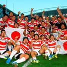 Japan players celebrate after the win over South Africa