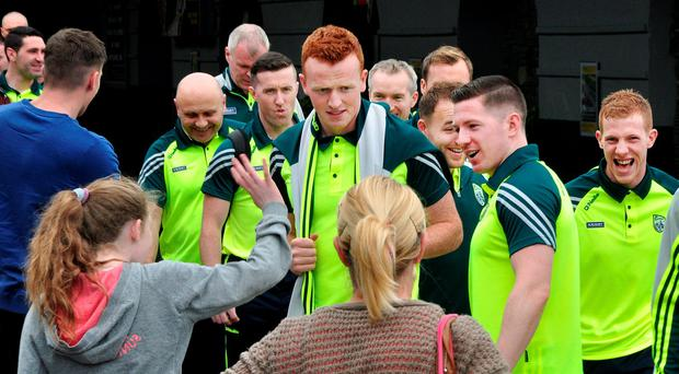 LEAVING FOR BATTLE: Johnny Buckley (centre) and the Kerry senior football team depart Killarney bound for Dublin yesterday for the All-Ireland final with Dublin. Photo: Neil Dinnen