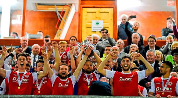 St Patrick's Athletic captain Ger O'Brien lifts the cup as his team-mates celebrate. EA Sports Cup Final, Galway United v St Patrick's Athletic. Eamonn Deacy Park, Galway. Picture credit: Matt Browne / SPORTSFILE