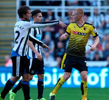 Daryl JanMaat and Florian Thauvin of Newcastle push Ben Watson of Watford from the pitch as he takes his time being substituted