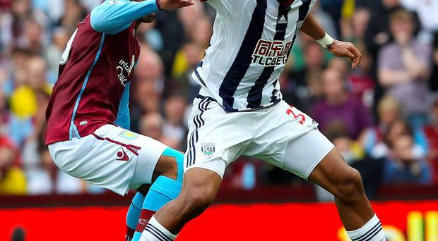 Aston Villa's English defender Joleon Lescott vies with West Bromwich Albion's Venezuelan striker Salomon Rondon