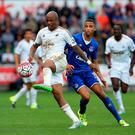 Andre Ayew of Swansea City and Brendan Galloway of Everton compete for the ball