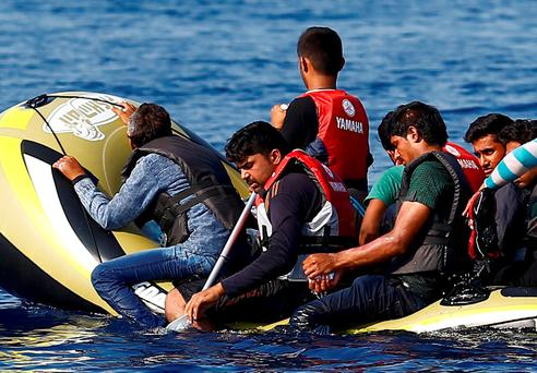 People paddle a boat from Turkey