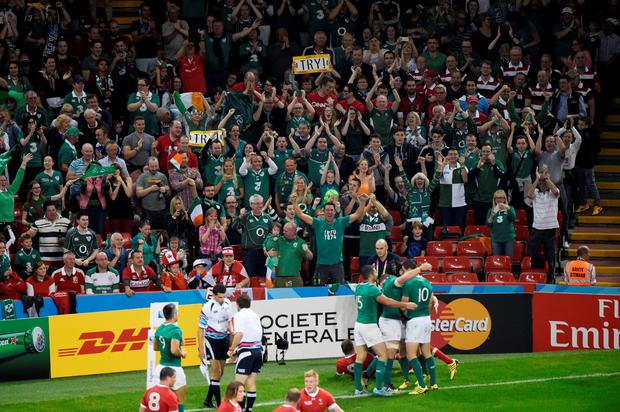 Ireland's Jonathan Sexton celebrates scoring a try in front of jubilant Ireland fans
