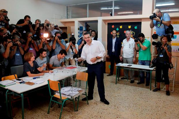 Former Greek prime minister and leader of leftist Syriza party Alexis Tsipras prepares to vote for the general elections at a polling station in Athens, Greece, September 20, 2015. REUTERS/Alkis Konstantinidis