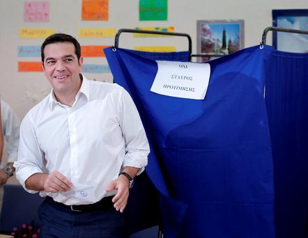 Leader of left-wing Syriza party and former Prime Minister Alexis Tsipras casts his vote at a polling station in Athens, Sunday, Sept. 20, 2015. (AP Photo/Lefteris Pitarakis)