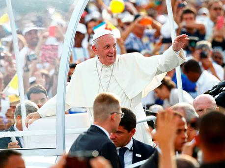 Pope Francis waves to the crowd upon arriving to give the first mass of his visit to Cuba in Havana's Revolution Square. Reuters/Tony Gentile