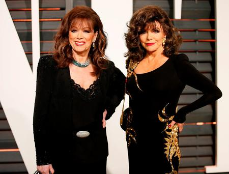 Actress Joan Collins (right) and writer Jackie Collins arrive at the 2015 Vanity Fair Oscar Party in Beverly Hills, California, in this February 22, 2015. Reuters/Danny Moloshok/Files