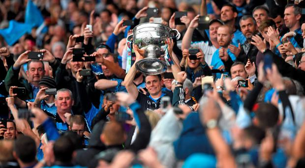 Dublin captain Stephen Cluxton lifts the Sam Maguire cup last September