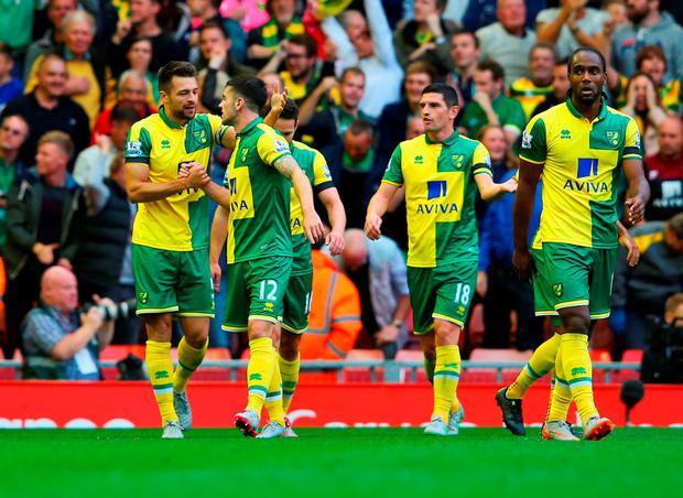 LIVERPOOL, ENGLAND - SEPTEMBER 20: Russell Martin of Norwich City (L) celebrates with Robbie Brady (12) as he scores their first and equalising goal during the Barclays Premier League match between Liverpool and Norwich City at Anfield on September 20, 2015 in Liverpool, United Kingdom. (Photo by Alex Livesey/Getty Images)