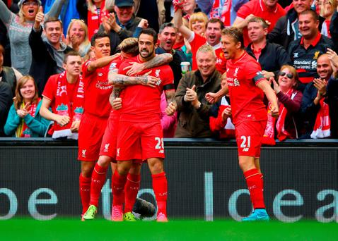 LIVERPOOL, ENGLAND - SEPTEMBER 20: Danny Ings of Liverpool (28) celebrates with team mates as he scores their first goal during the Barclays Premier League match between Liverpool and Norwich City at Anfield on September 20, 2015 in Liverpool, United Kingdom. (Photo by Alex Livesey/Getty Images)