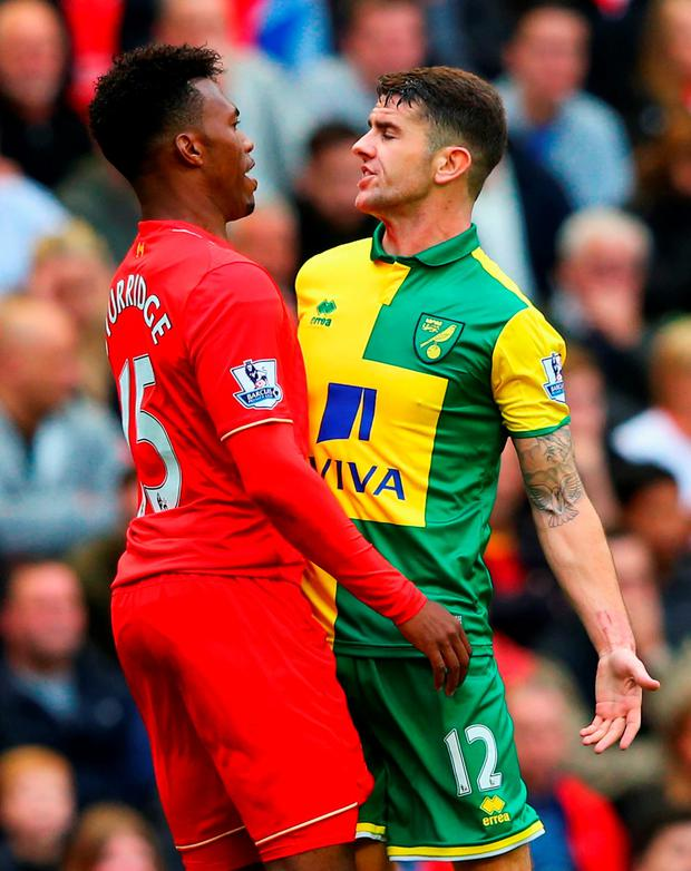 Daniel Sturridge of Liverpool and Robbie Brady of Norwich City clash during the Barclays Premier League match between Liverpool and Norwich City at Anfield on September 20, 2015 in Liverpool