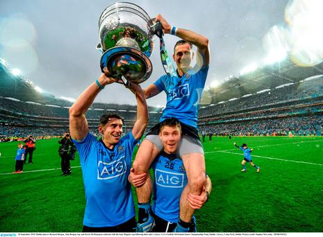Dublin players Bernard Borgan, Alan Brogan, top, and Kevin McManamon celebrate with the Sam Maguire cup following their side's victory