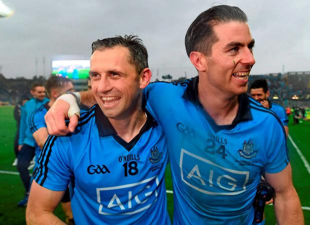 20 September 2015; Dublin's Alan Brogan, left, and Michael Darragh MacAuley celebrates after the final whistle. GAA Football All-Ireland Senior Championship Final, Dublin v Kerry, Croke Park, Dublin. Picture credit: Stephen McCarthy / SPORTSFILE