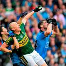 Kieran Donaghy, Kerry, in action against Rory O'Carroll, left, and Michael Darragh MacAuley, Dublin. GAA Football All-Ireland Senior Championship Final, Dublin v Kerry, Croke Park, Dublin. Picture credit: Ramsey Cardy / SPORTSFILE