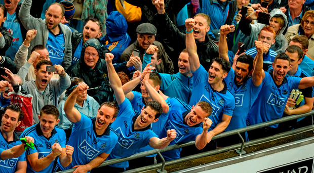 20 September 2015; Dublin players and supporters celebrate as Stephen Cluxton lifts the Sam Maguire. GAA Football All-Ireland Senior Championship Final, Dublin v Kerry, Croke Park, Dublin. Picture credit: D?ire Brennan / SPORTSFILE