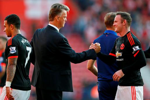 Manchester United's Wayne Rooney shakes hands with manager Louis van Gaal after the game