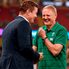 Joe Schmidt shares a joke with Brian O'Driscoll at the Millennium Stadium