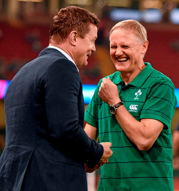 Joe Schmidt shares a joke with Brian O'Driscoll during the World Cup