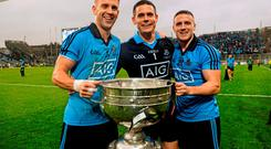 Dublin players, from left, Jonny Cooper, Stephen Cluxton and Davy Byrne, celebrate with the Sam Maguire cup after the game