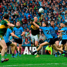 Kieran Donaghy sets up Killian Young for a late chance despite the massed ranks of the Dublin defence as Kerry spurned a late goal opportunity
