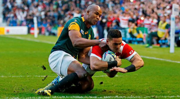 Karne Hesketh scores the last-gasp winning try for Japan against South Africa