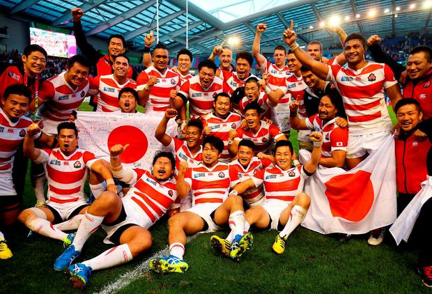 Japan celebrate their victory over South Africa