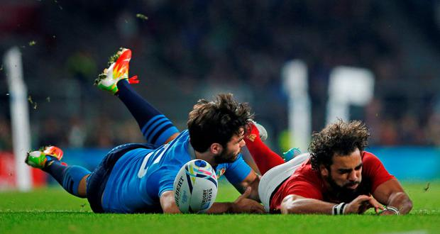 France winger Yoann Huget is injured in a clash with Italy Luke McLean