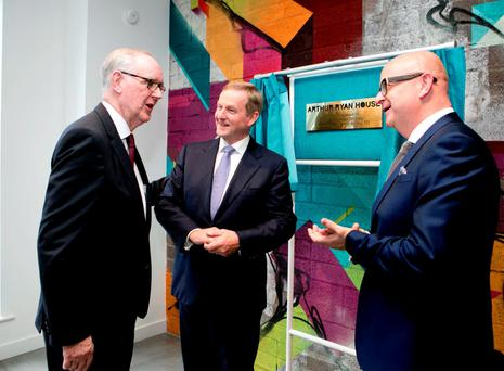 Arthur Ryan, chairman of Primark, with Taoiseach Enda Kenny and Primark CEO Paul Marchant at the newly redeveloped headquarters on Parnell Street, Dublin.