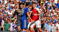 Chelsea's Diego Costa clashes with Arsenal's Gabriel Paulista