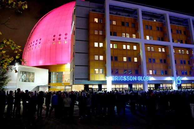 People wait in line to enter the venue for a U2 concert at the Ericsson Globe Arena in Stockholm, Sweden