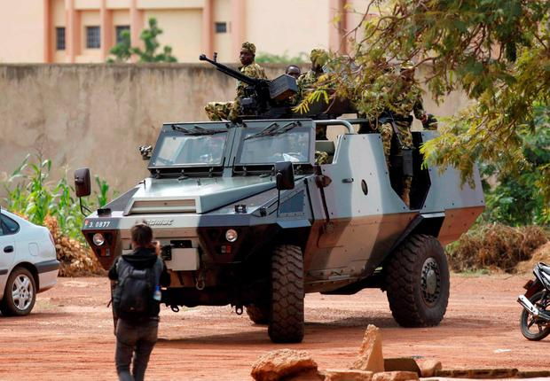 Presidential guard soldiers in an armoured vehicle outside the Laico hotel were mediators were meeting to resolve the crisis Credit: REUTERS/Joe Penney