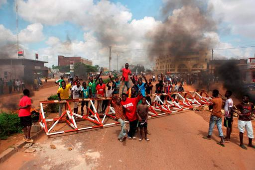 Anti-coup protesters gather at a barricade in Ouagadougou, Burkina Faso Credit: REUTERS/Joe Penney