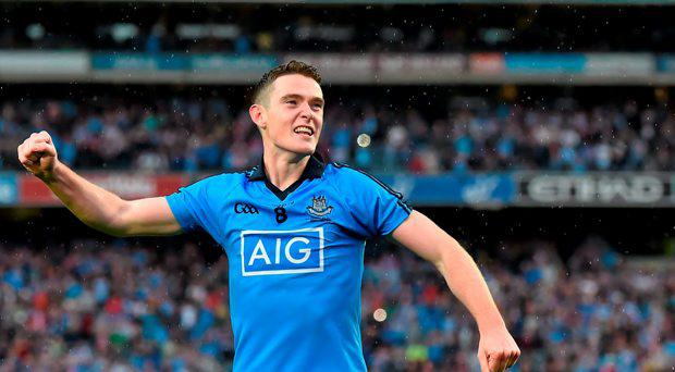 Dublin's Brian Fenton celebrates in front of Hill 16 after the game