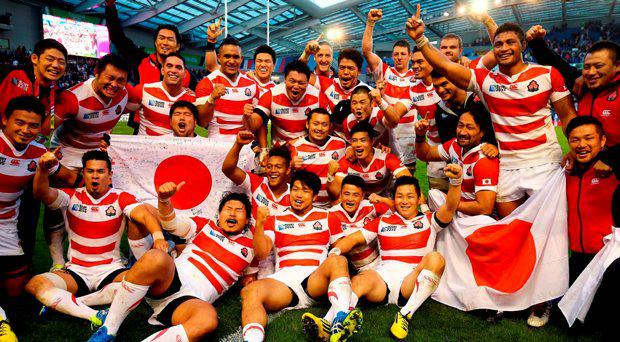 Japan celebrate victory over South Africa during the Rugby World Cup match at the Brighton Community Stadium, Brighton