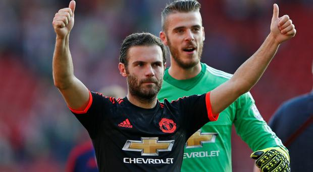 Manchester United's Juan Mata and David De Gea acknowledge the fans after the game