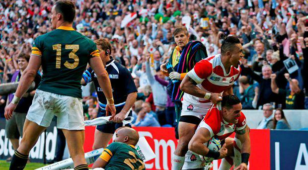 Japan's Karne Hesketh celebrates after scoring their third try to win the game