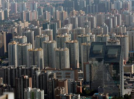 Commercial buildings and apartments are seen in central Beijing, China