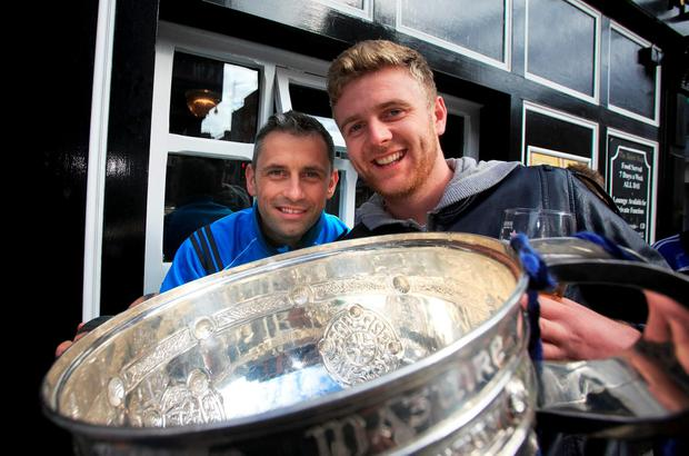Member of the Dublin GAA team Alan Brogan celebrates with fan Paddy Miskell in The Boars Head pub, Dublin after winning the Sam Maguire Cup. Photo: Gareth Chaney Collins