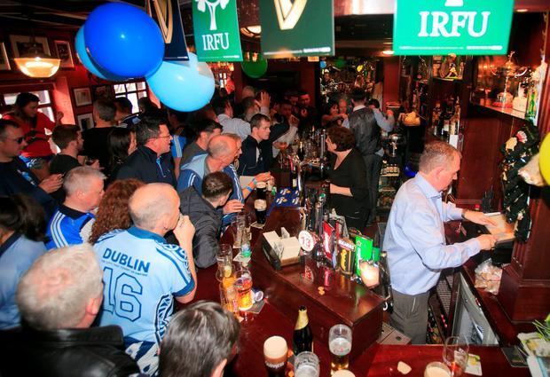 Dublin fans in The Boars Head pub, Dublin after winning the Sam Maguire Cup. Photo: Gareth Chaney Collins