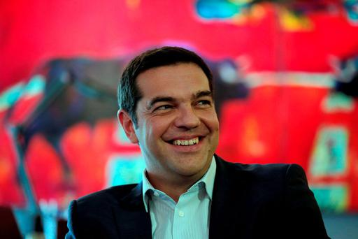 Left-wing Syriza party leader Alexis Tsipras smiles during his meeting with leader of the right-wing Independent Greeks party Panos Kammenos at his office in Athens (AP Photo/Lefteris Pitarakis)