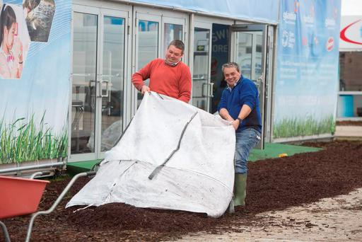 Alan Gee and Liam Geoghegan spreading bark on the Glanbia stand in preparation for the National Ploughing Championships 2015 at Ratheniska, Co. Laois