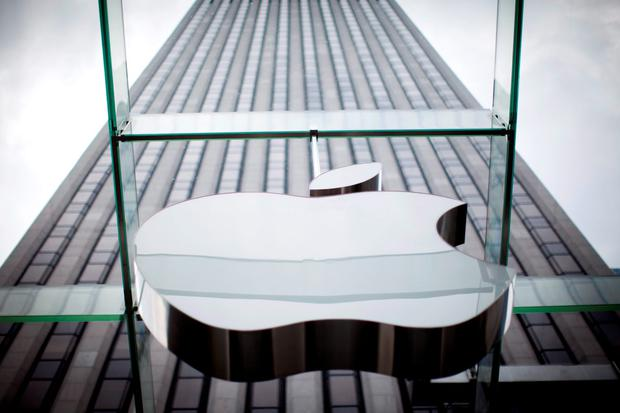 An Apple logo hangs above the entrance to the Apple store on 5th Avenue in the Manhattan borough of New York City, in this July 21, 2015, file photo. REUTERS/Mike Segar/Files
