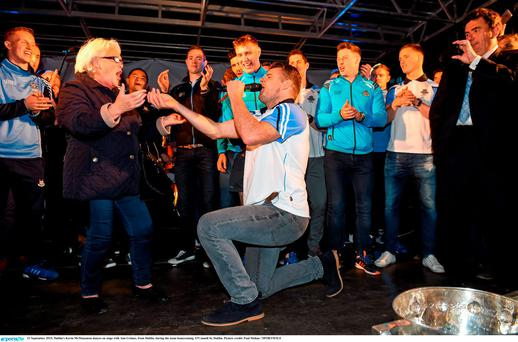 21 September 2015; Dublin's Kevin McManamon dances on stage with Ann Grimes, from Dublin, during the team homecoming. O'Connell St, Dublin. Picture credit: Paul Mohan / SPORTSFILE