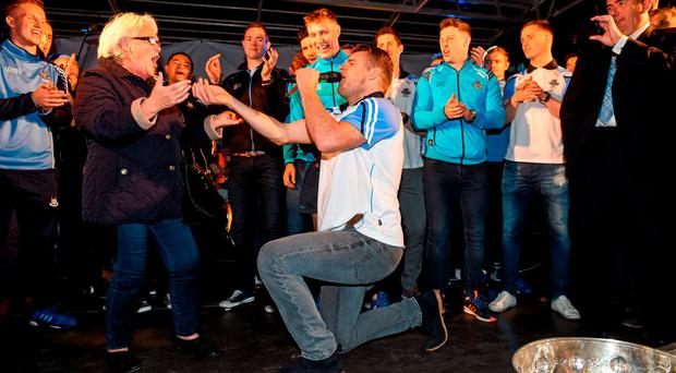 Dublin's Kevin McManamon dances on stage with Ann Grimes, from Dublin, during the team homecoming.