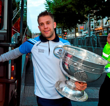 Jonny Cooper arrives with the Sam Maguire trophy for Dublin's 'homecoming' in O'Connell Street last night