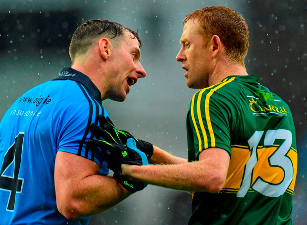 Philly McMahon (left) speaking to Kerry's Colm Cooper