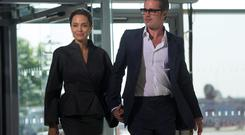 US actress and special UN envoy Angelina Jolie (L) and her husband US actor Brad Pitt pose for pictures upon arrival on the fourth day of the Global Summit to End Sexual Violence in Conflict in London