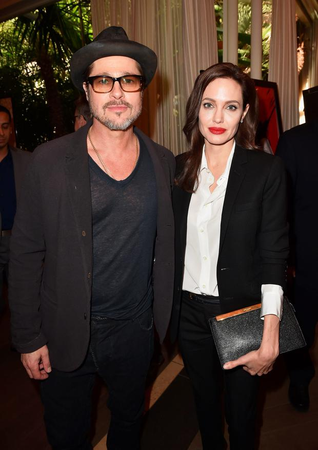 Actor Brad Pitt (L) and actress/director Angelina Jolie attend the 15th Annual AFI Awards at Four Seasons Hotel Los Angeles at Beverly Hills on January 9, 2015 in Beverly Hills, California. (Photo by Kevin Winter/Getty Images for AFI)